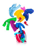 Colorful clothes are falling in a red backpack on a white. Background Royalty Free Stock Photography