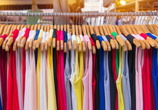 Colorful clothes fashion hang on a shelf at flea market shopping Royalty Free Stock Photo