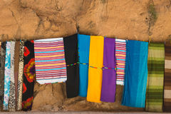 The colorful clothes hang on the rope for sales Royalty Free Stock Photography