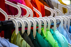 Colorful clothes on hangers Royalty Free Stock Photos