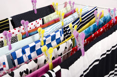 Colorful clothes hanging on a clothes horse to dry. Royalty Free Stock Photo