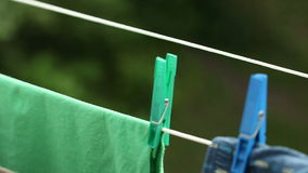 Colorful clothes hanging to dry on a laundry line outdoor Stock Images