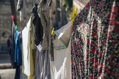 Colorful clothes hanging to dry on a laundry line in a sunny day in Jerusalem Royalty Free Stock Image