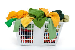 Colorful clothes in laundry basket. Green, yellow. Stock Images