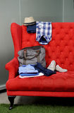 Colorful Clothes On A Chair Stock Images