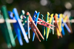 Colorful clothes-pegs Stock Photos