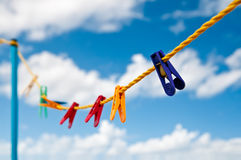 Colorful clothes pegs Stock Images