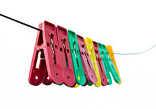 Colorful clothes pegs hanging Royalty Free Stock Image