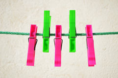 Colorful clothes pegs on line. Pink and green Royalty Free Stock Photos