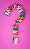 Colorful clothes pegs on pink Royalty Free Stock Image