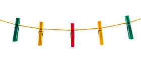 Colorful clothes pegs on a rope Royalty Free Stock Images