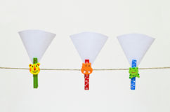 Colorful clothes-pin holding White paper Royalty Free Stock Photo