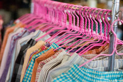 Colorful clothes with pink hanger royalty free stock photo