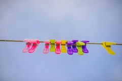 Colorful clothes pins. On blue sky Stock Photo