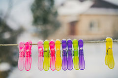 Colorful clothes pins. With blurred background Royalty Free Stock Photos
