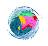 Colorful clothes rotates in splashes of water isolated on white. Background Royalty Free Stock Images