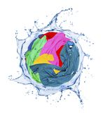 Colorful clothes rotates in a swirling splashes of water. On white background stock photo