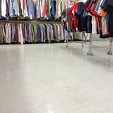 Colorful clothes for sale in a second hand store Royalty Free Stock Photo