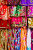 Colorful clothes and saris. On display royalty free stock photo