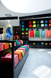 Colorful clothes shop interior Stock Photography