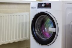 Colorful clothes and towels in washing machine.  Stock Photo
