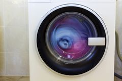 Colorful clothes and towels in washing machine.  Royalty Free Stock Images
