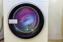 Colorful clothes and towels in washing machine.  Stock Image