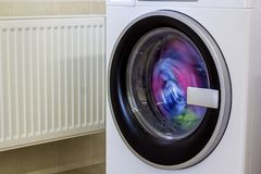 Colorful clothes and towels in washing machine.  Royalty Free Stock Photo