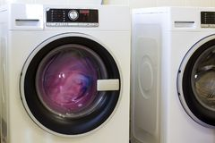 Colorful clothes and towels in washing machine.  Stock Images