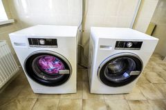 Colorful clothes and towels in washing machine.  Royalty Free Stock Image