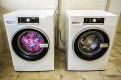Colorful clothes and towels in washing machine.  Stock Photos