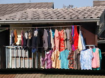 Colorful clothes washing hanging on a balcony Royalty Free Stock Photo