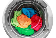Colorful clothes in the washing machine Royalty Free Stock Photos