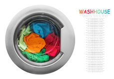 Colorful clothes in the washing machine stock images