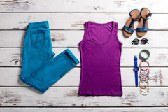 Colorful clothes on wooden background. Royalty Free Stock Photos