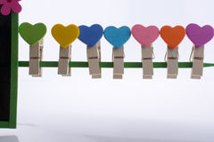 Colorful clothespin attached on a line. Colorful clothespin attached attached on a line side by side Stock Photos