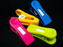 Colorful clothespin on black background. Stock Photos