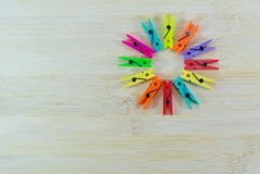 Colorful clothespin. Circle colorful clothespin on wooden base Stock Photo