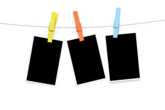 Colorful clothespin hang blank photo paper Royalty Free Stock Images