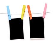 Colorful clothespin hang blank photo paper Stock Photography