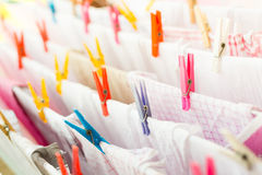 Colorful clothespin with kitchen towels outside Stock Photos