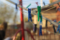 Colorful Clothespins On Clothesline Stock Images