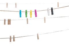 Colorful clothespins on a clothesline , clamp peg housework Royalty Free Stock Image