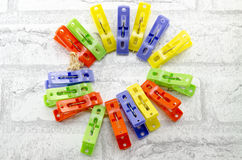 Colorful clothespins forming a circle Stock Images