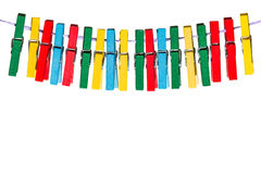 Colorful clothespins hanging on a line in a row Royalty Free Stock Image