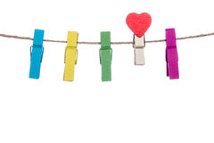 Colorful clothespins with heart  shape  clip on a clothesline Stock Photos