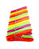 Colorful clothespins in a row Stock Photo