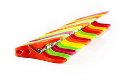 Colorful clothespins in a row Royalty Free Stock Images