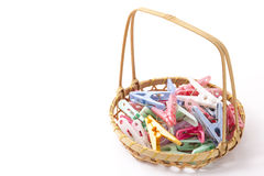 Colorful clothespins that were placed in a bamboo basket Stock Photo