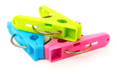 Colorful clothespins on white Royalty Free Stock Images